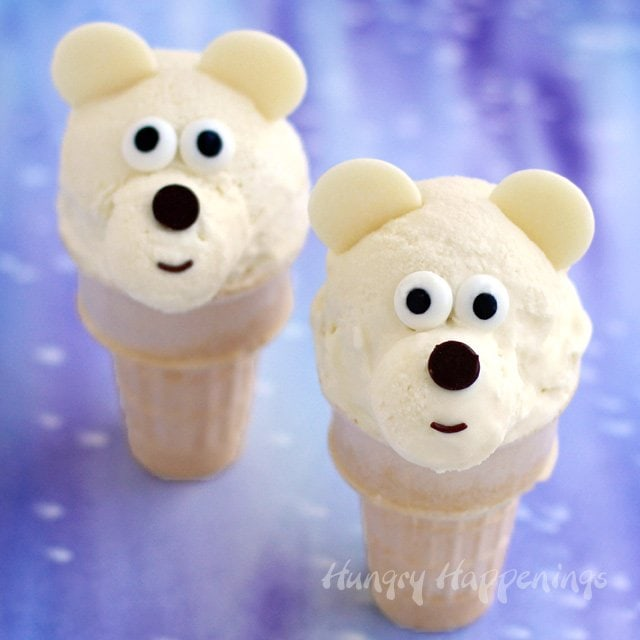 Chill out with some adorable Ice Cream Cone Polar Bears made from homemade Toasted Coconut Cheesecake Ice Cream. Find the recipe at HungryHappenings.com