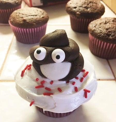Chocolate smiling poo emoji cupcakes.