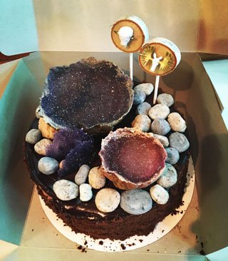 Edible fudge rocks and geodes add an earthy feel to this chocolate cake.
