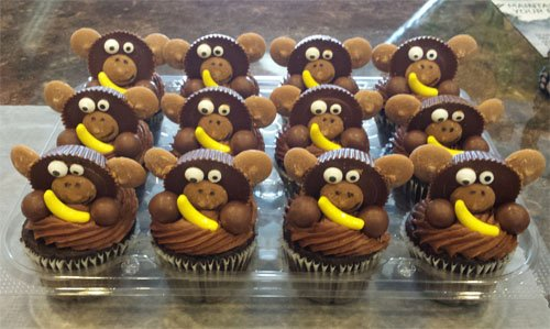 Monkey Cupcakes topped with Reese's Cups and Banana Fruit Runts.