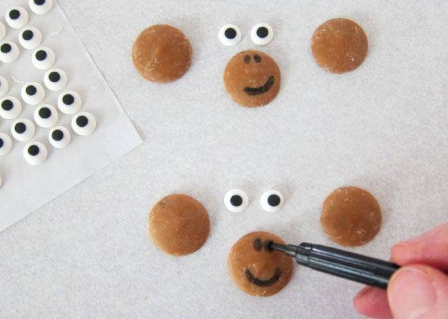 draw nostrils and a smile onto peanut butter candy melts to make a monkey's face