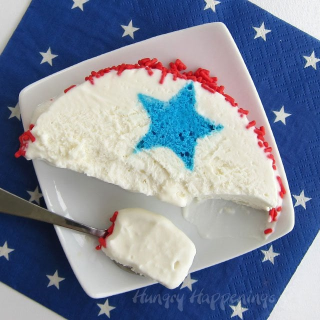 Cake, Ice Cream and Sprinkles, all in one festive 4th of July Dessert. Make a Red, White and Blue Ice Cream Roll for your patriotic party. Recipe from HungryHappenings.com