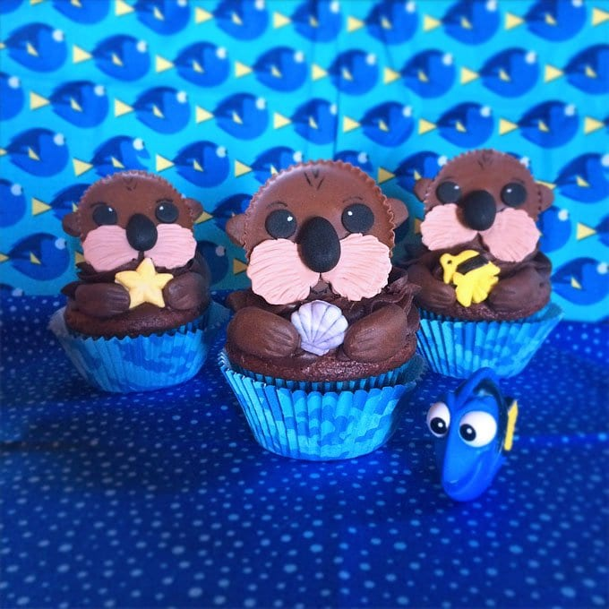 Top chocolate cupcakes with Reese's Cups decorated like Sea Otters.