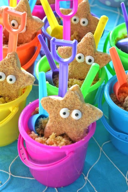 Starfish Sugar Cookies are coated in crushed graham cracker crumbs and served in cute little beach pails filled with spice cake.
