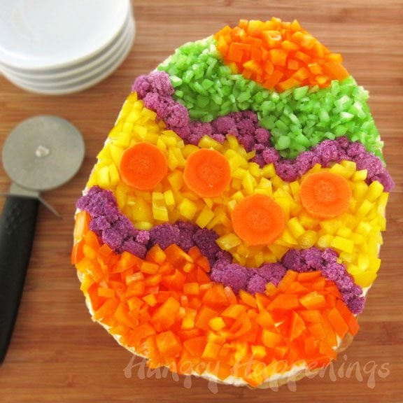 Veggie Pizza Easter Egg. Make your own festively decorated pizza using your favorite vegetables.