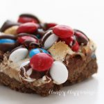 Red, White and Blue M&M's Top these festive looking S'mores Magic Bars and make the perfect dessert for your 4th of July parties. Recipe from HungryHappenings.com