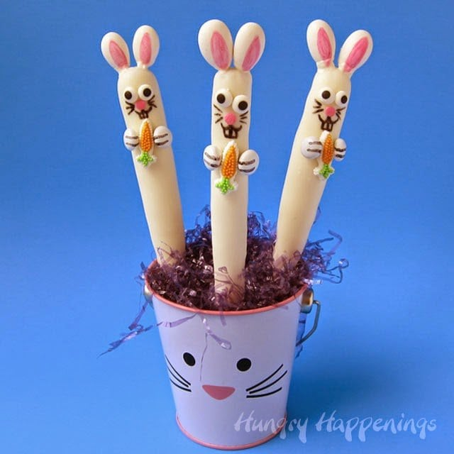 White chocolate-dipped pretzel bunnies in a bunny pail.