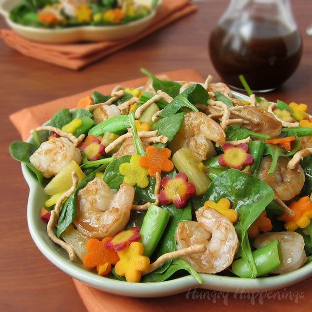 Add a bit of color to your summer salads by tossing in some yellow, orange and purple carrot flowers. This Hawaiian Luau Spinach Salad will make a wonderful lunch for a pool party or any summertime event.
