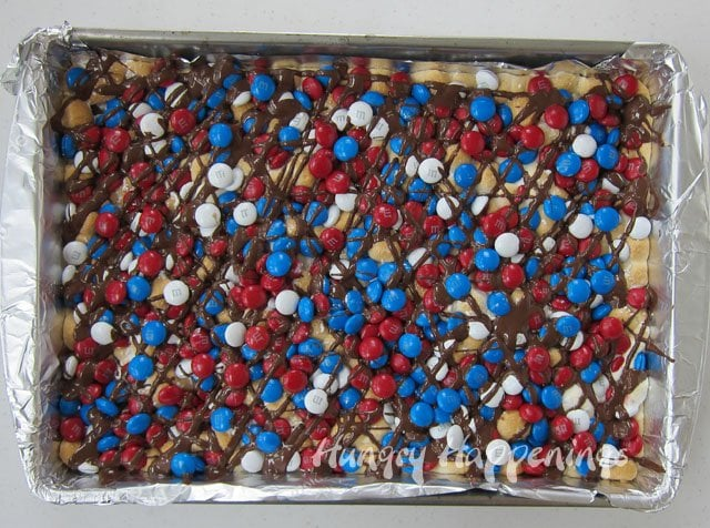 "Red, white, and blue s'mores magic bars in a 9x13"" pan."