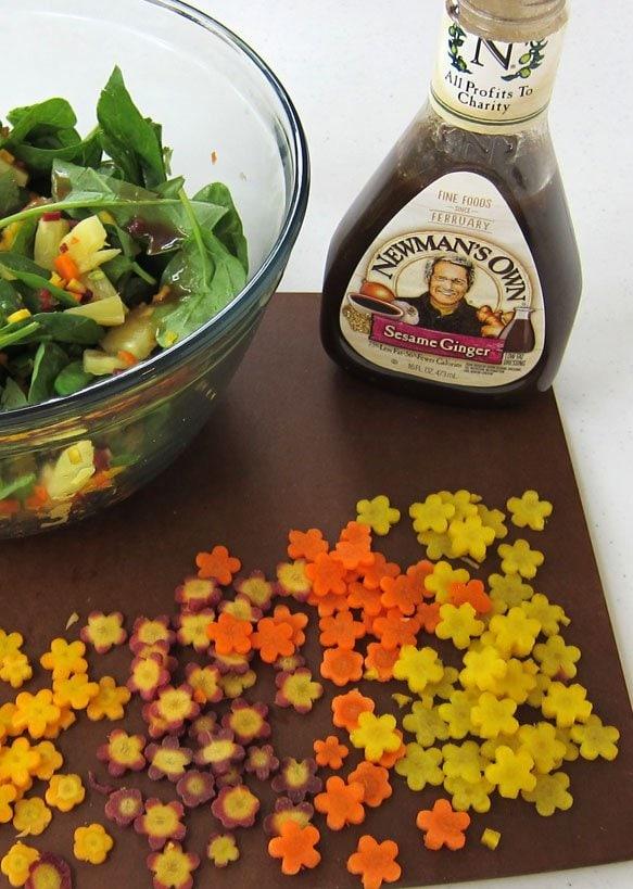 Cut rainbow carrots into pretty flowers to toss into a Hawaiian Luau Spinach and Shrimp Salad.
