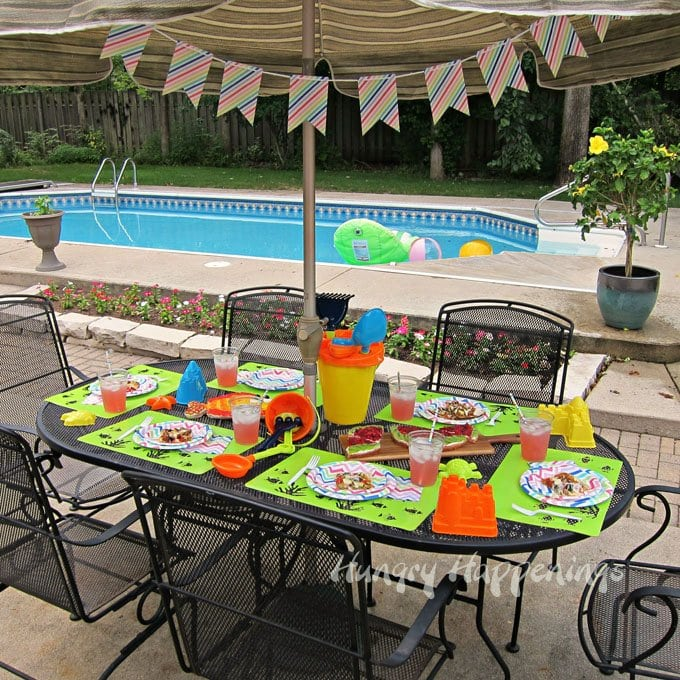How to set up a super easy table for a pool party using beach toys.