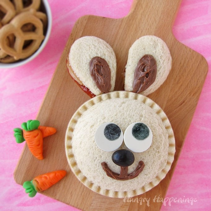 bunny sandwich made with a peanut butter and jelly Uncrustables, Nutela, and candy eyes