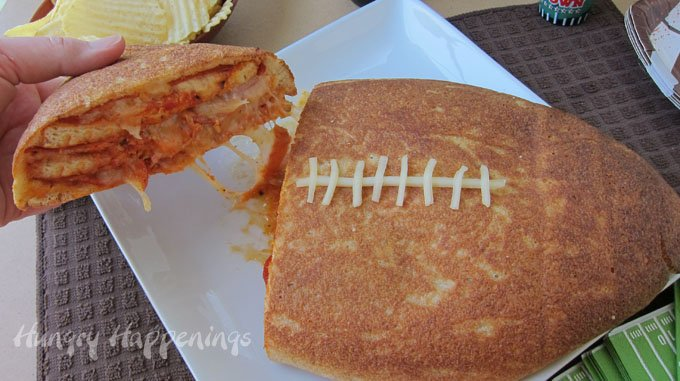 Cut into the Football Pizza Cake to reveal layers of pizza crust, sauce, cheese, and pepperoni. This hearty appetizer will feed a crowd of hungry football fans.