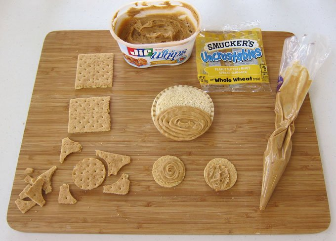 It's so easy to make your kid's lunch fun. Use Smucker's® Uncrustables® to make adorable monkeys. They make a perfect meal for a day at the zoo.