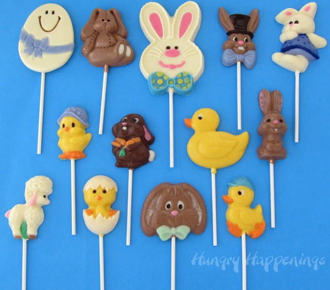 Easter lollipops are hand painted using colored candy melts to include Easter eggs, bunnies, ducks, chicks. and lambs.