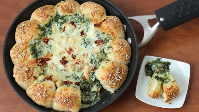 Break off a piece of mozzarella cheese filled pizza crust and scoop up some cream spinach alfredo dip and enjoy bits of chicken, bacon, and sun-dried tomatoes in every bite.