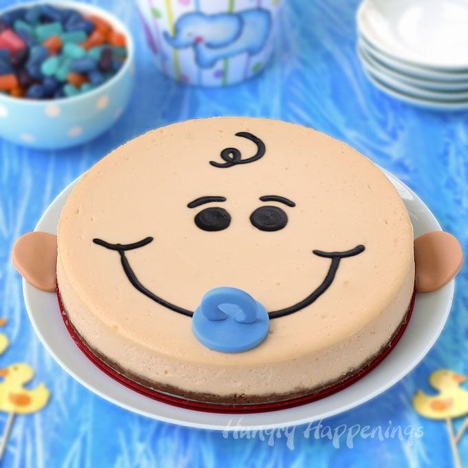 Add a touch of whimsy to your baby shower dessert table by serving this adorable Peach Cobbler flavored Cheesecake Baby. Find the tutorial at Hungry Happenings.