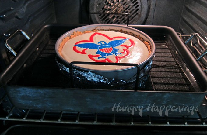 In order to get a cheesecake with a smooth creamy texture that doesn't crack, you need to bake it in a water bath.