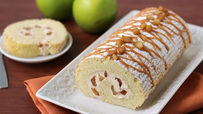 Combine the flavors of caramel apple pie with yellow cake and cheesecake and you've got this amazing fall dessert. Get ready to dig into this Caramel Apple Cake Roll.