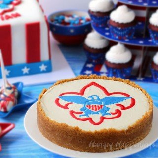 A great dessert idea for an Eagle Scout Ceremony, this decorated Eagle Scout Cheesecake is easy to make using a piping gel transfer.