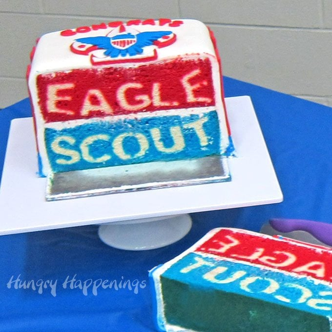 Cut into the regal red, white and blue Eagle Scout cake to reveal the amazing surprise hiding inside.
