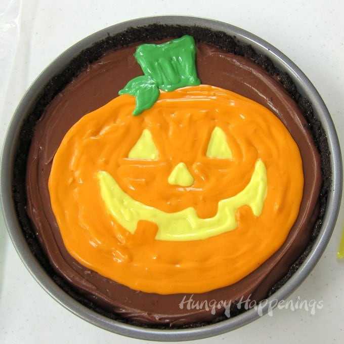 If you can draw a jack-o-lantern you can make this Painted Pumpkin Cheesecake for you Halloween party.