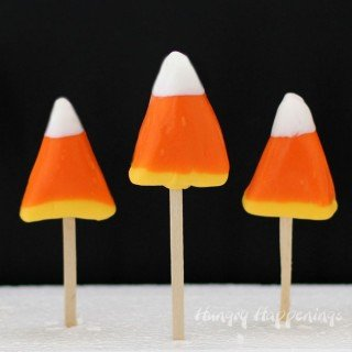 Dip creamy honey scented vanilla centers in orange, yellow, and white candy coating to create these sweet Candy Corn Pops for Halloween. Not only do they look like the iconic holiday candy, but they taste like them too.