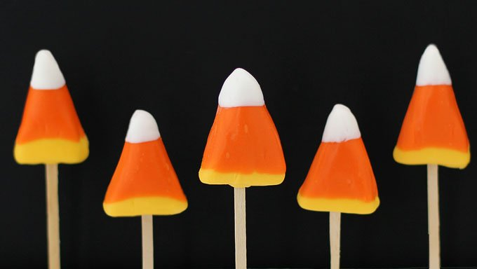 Candy Corn Pops with honey scented vanilla candy centers look and taste like the iconic Halloween confection.