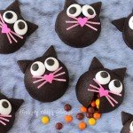 These wickedly cute Candy filled Black Cat Cookies will make the purrfect Halloween treat. See the tutorial at HungryHappenings.com