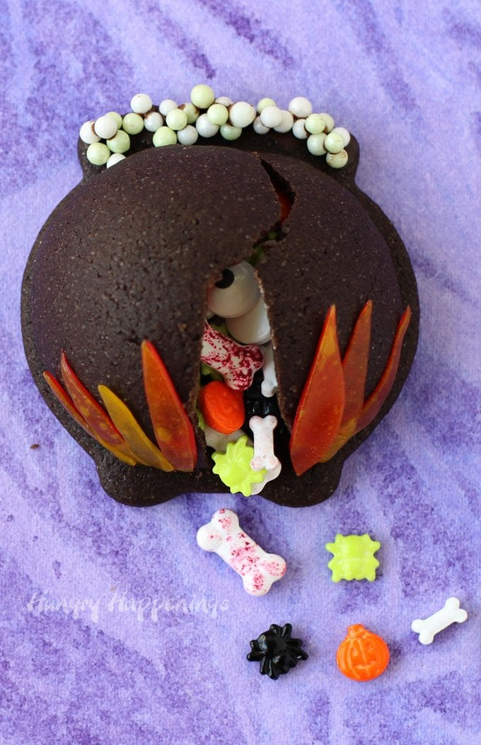 Conjure up a magical Halloween treat. These Candy Filled Cauldron Cookies are fun to make and even more fun to eat. See the recipe at HungryHappenings.com.