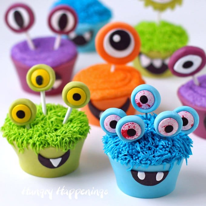 Here's a fun Halloween treat for kids and adults that is 100% edible, even the cupcake wrappers. See the tutorial to make brightly colored cupcake monsters at HungryHappenings.com