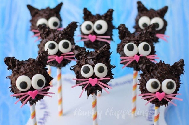 Now these are black cats no one would be scared of, even on Halloween. Each Peanut Butter Fudge Filed Black Cat Pop is dipped in chocolate and decorated with sweet candy eyes, nose and whiskers. See the step-by-step tutorial at Hungry Happenings.