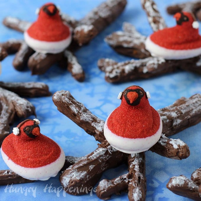 Turn PEEPS® Red Velvet Chicks Dipped in Cream Flavored Fudge into Christmas Cardinals Perched on Snow Covered Chocolate Caramel Pretzel Branches.