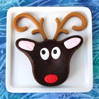 Cute Brownie Rudolph with Peanut Butter Candy Antlers is easy to make using a Wilton Reindeer Pan.