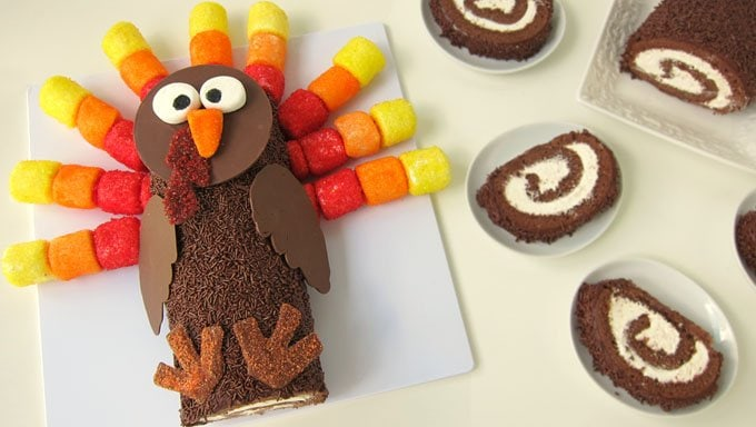 This Thanksgiving have some fun with your dessert by turning a chocolate cake roll into a turkey with colorful marshmallow feathers.