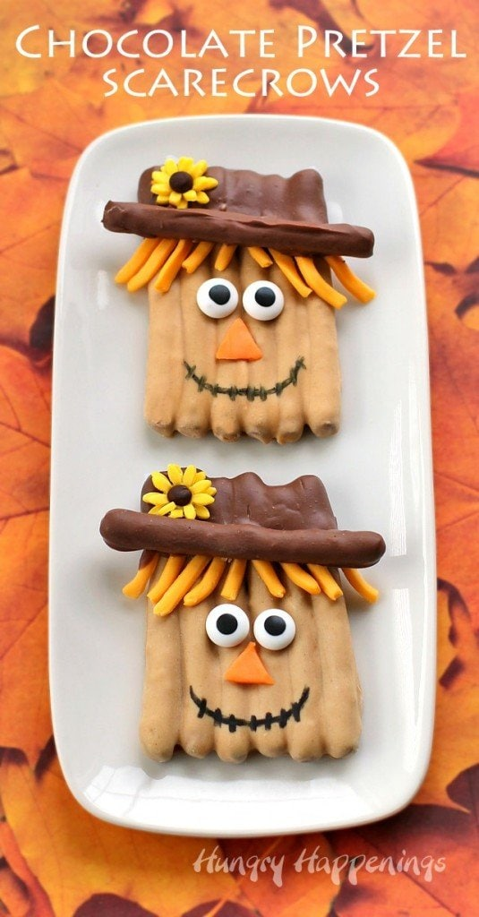 chocolate pretzel scarecrows decorated with Reese's Peanut butter chips, milk chocolate, candy eyes, and modeling chocolate