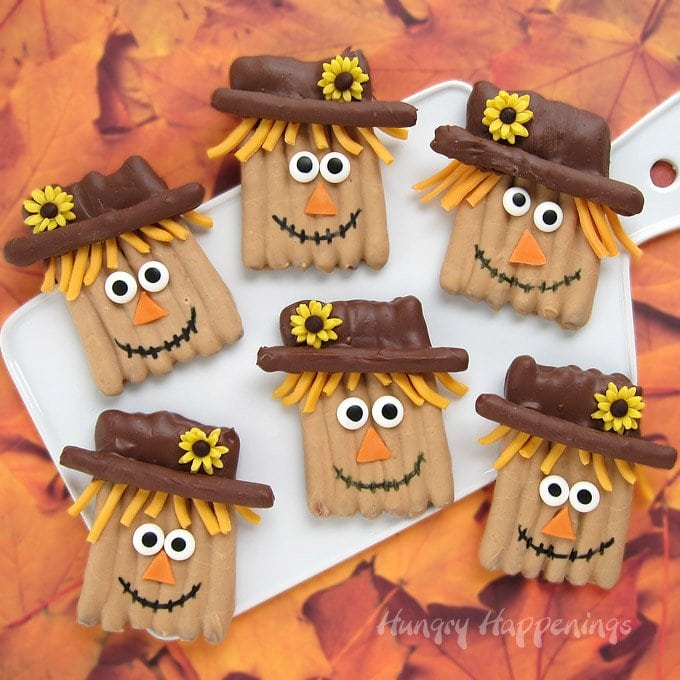 Turn dipping pretzels into adorably cute Candy Coated Pretzel Scarecrows this fall. They will make a fun Thanksgiving Day dessert.