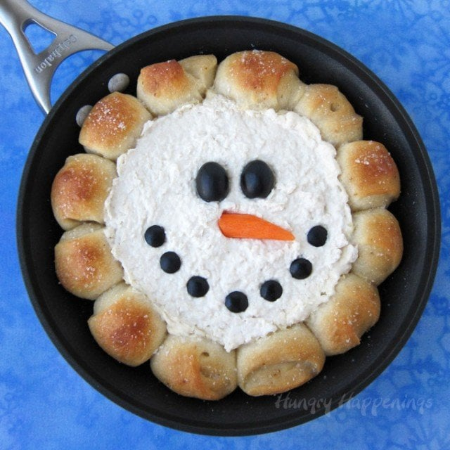 "Warm the hearts and fill the bellies of your holiday party guests by serving a festive Christmas appetizer. When you pull this Skillet Dip Snowman out of the oven everyone will ""ooh"" and ""ahh,"" before ripping off pieces of salty bread so they can scoop up the creamy chicken dip in the middle."
