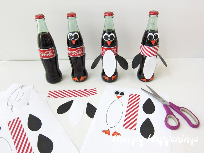 Turn Coca-Cola Bottles into adorable Penguins using a free printable.