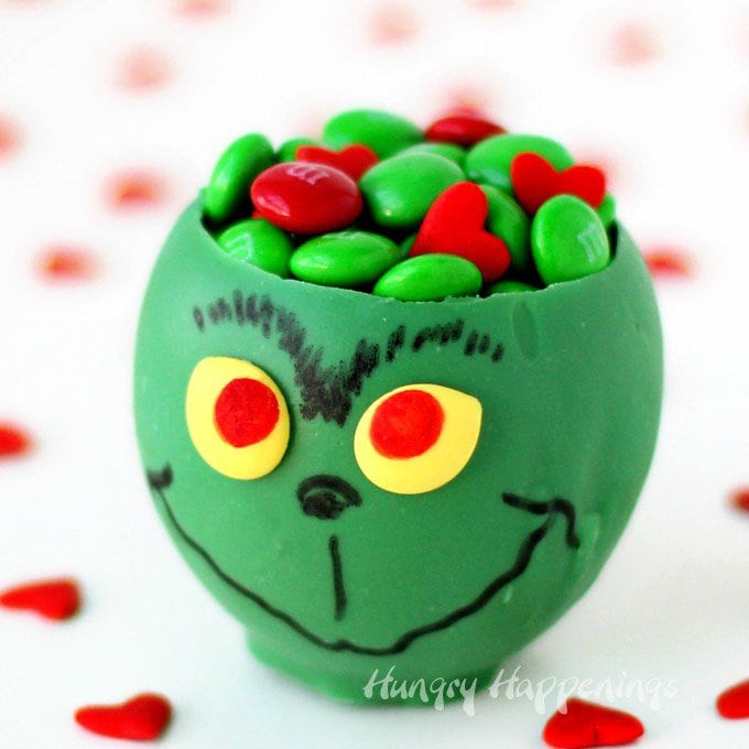 Serve small treats or your favorite ice cream in a green Grinch Candy Cup. They are fun to make using a balloon. See how at HungryHappenings.com.