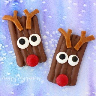 This Christmas have fun in the kitchen decorating salty and sweet Chocolate Pretzel Reindeer with shiny red candy coated chocolate noses and caramel antlers. They are as fun to make as they are to eat.