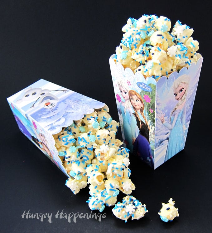 White chocolate popcorn speckled with snowflake sprinkles and blue jimmies make a perfect treat for a Disney Frozen party.