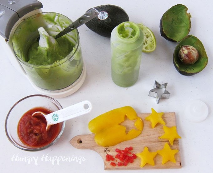 How to make Christmas Tree Snacks using guacamole, peppers, and tomatoes.