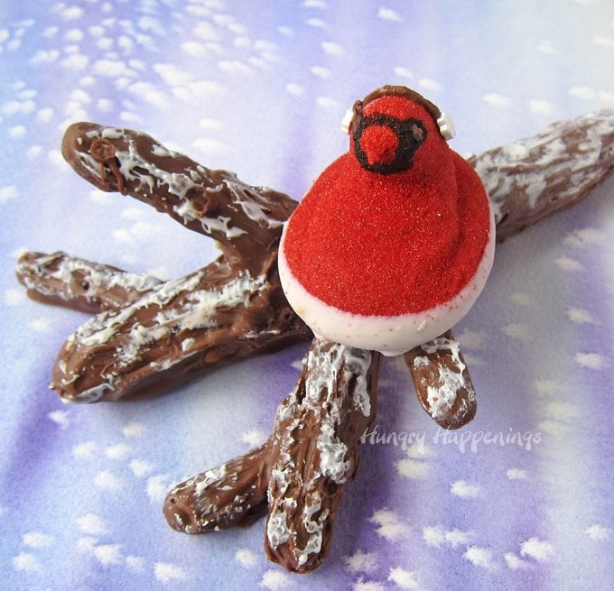 This Christmas, have a little fun inside making holiday treats that look like they should be outside. These Red Cardinal Peeps® Perching on Snow Covered Chocolate Caramel Pretzel Branches can be packaged up and given as gifts or be served as dessert.
