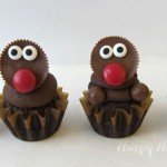 Decorate the ultimate chocolate cupcakes with a Reese's Cup Rudolph with a red Mega M&M nose and candy cane antlers.