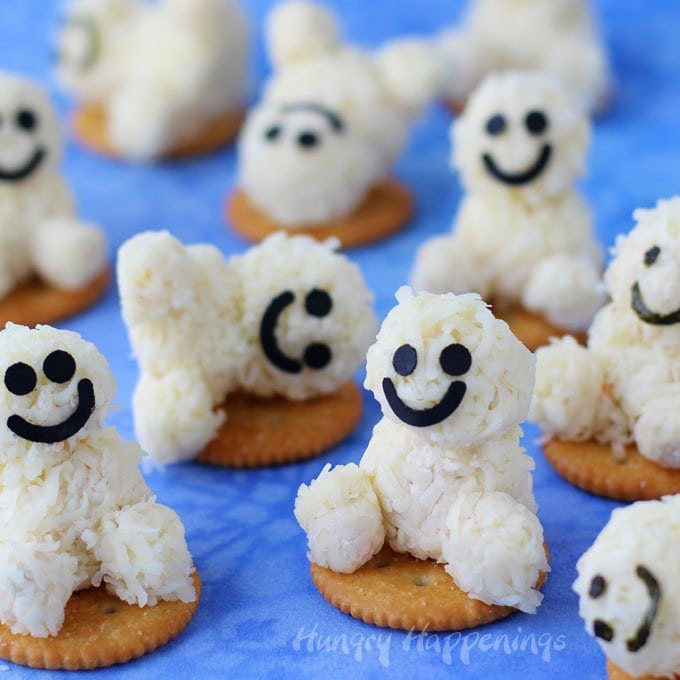 Cheesy Snowgie Snacks are so much fun to make and to eat and your kids are going to love them. They are perfect for a Frozen party or an afternoon snack. See how to make them at HungryHappenings.com