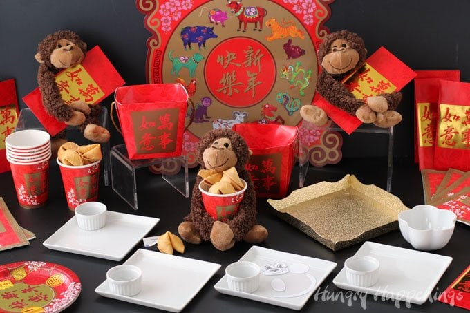 Decorate a festive table for a Year of the Monkey Chinese New Year party.