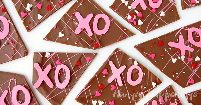 Give your sweetheart some Hugs and Kisses Chocolate Bark for Valentine's Day and they'll give you some lovin' right back. This milk chocolate bark topped with bright pink X's and O's is easy to make and even easier to share. See the tutorial at HungryHappenings.com.