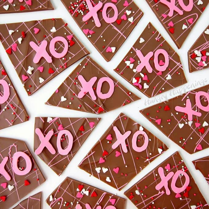 Show your loved ones how much you care by making them some Hugs and Kisses Chocolate Bark. This sweet milk chocolate bark is sprinkled with bright pink X's and O's and is a perfect Valentine's Day treat.