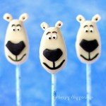 Transform a store bought white chocolate peanut butter fudge filled egg into Norm of the North Lollipops using either modeling chocolate or chewy chocolate and vanilla candies. See how at HungryHappenings.com.